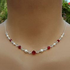 https://www.amazon.in/gp/search/ref=as_li_qf_sp_sr_il_tl?ie=UTF8&tag=fashion066e-21&keywords=pearls with red beads&index=aps&camp=3638&creative=24630&linkCode=xm2&linkId=714a67df8253884d8fb68ab5bca5adf0