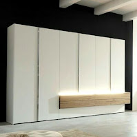 White modern wardrobe design with cool lighting