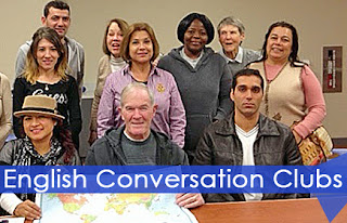 "Group people standing behind a table above the words, ""English Conversation Clubs"""