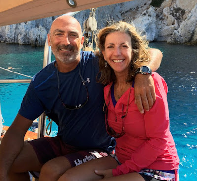Smiling couple on a sailboat