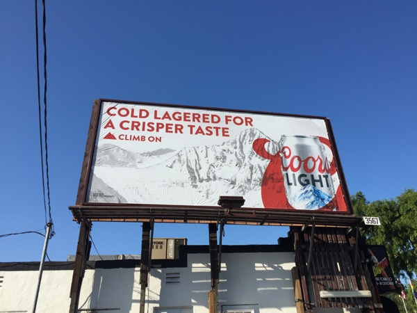 Coors Light Cold lagered crisper taste billboard