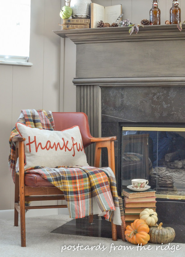 pillow and plaid blanket scarf mid century wooden arm chair