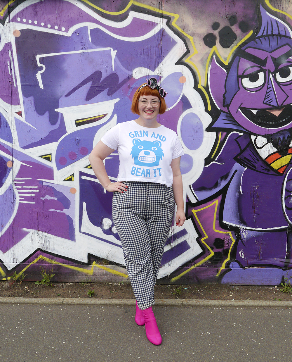 Scottish fashion blogger Helen from Wardrobe Conversations in front of a painted wall