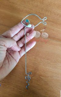 Holding a wire wrapped fish bookmark