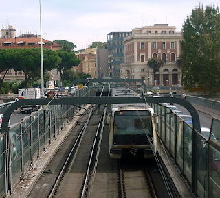 A Linea A metro train crosses the Ponte Pietro Nenni, which carries trains over the River Tiber in Rome