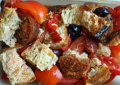 Tomatoes, bread, olives and peppers.