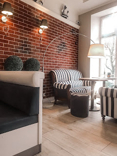 a nautical themed restaurant with bare brick walls