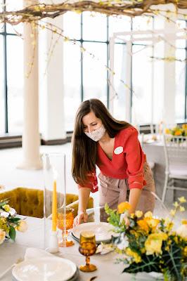 Jaclyn Fraser wedding coordinator fixing table