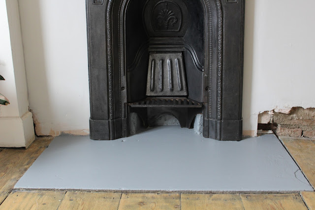 grey painted bedroom hearth