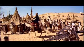 Charlton Heston riding camel