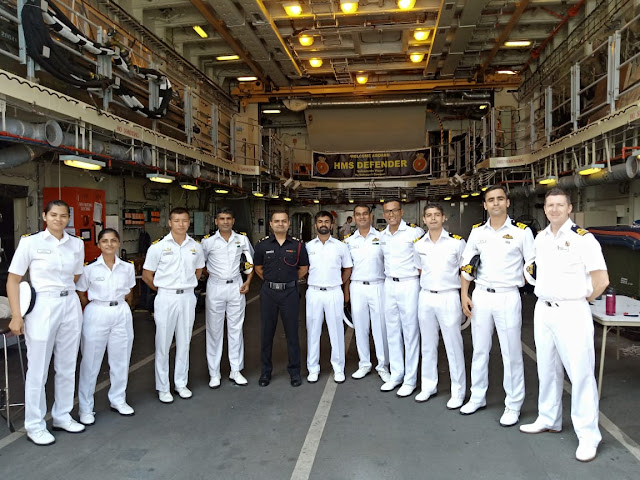 Image Attribute: HMS Defender crew with India Navy officials at Mormugao Port, Goa / Dated: November 10, 2019. / Source: Indian NavyImage Attribute: HMS Defender crew with India Navy officials at Mormugao Port, Goa / Dated: November 10, 2019. / Source: Indian Navy