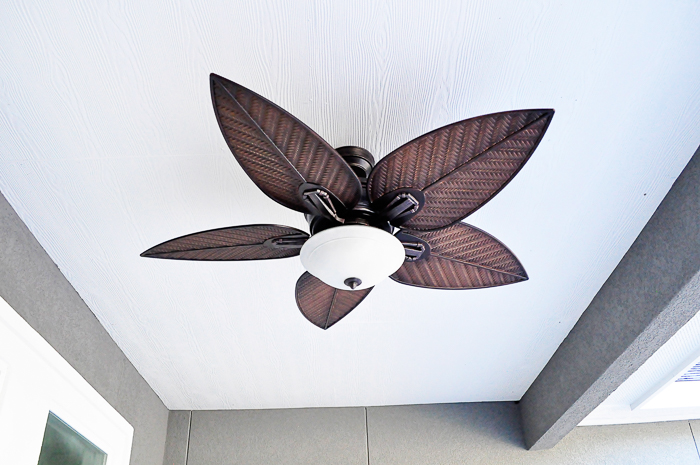 Outdoor Palm Leaf Ceiling Fan and Light: Our lighting choices for our new home. Learn how we saved $1000.   via monicawantsit.com