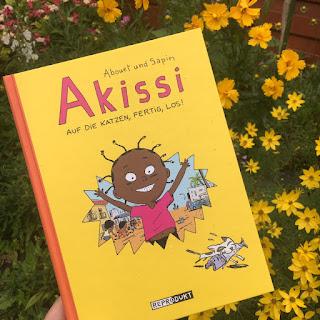 """""""Akissi: Auf die Katzen, fertig, los!"""" von Marguerite Abouet und Mathieu Sapin, erschienen im Verlag Reprodukt, Rezension auf Kinderbuchblog Familienbücherei"""