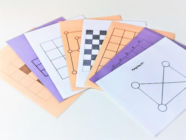na zdjęciu kilka plansz z grami wydrukowanymi i zalaminowanymi