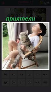 около окна сидят мальчик и кошка как старые приятели
