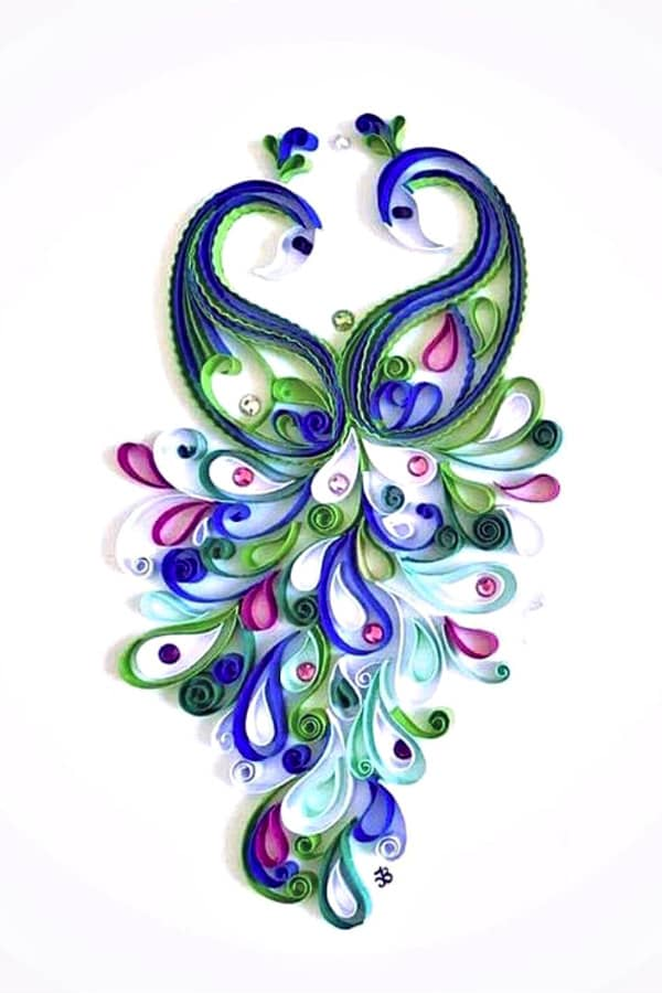 pair of quilled peacocks facing one another