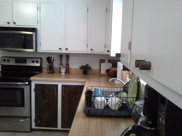 kitchen cabinet makeover reveal white and wood stained wooden knobs