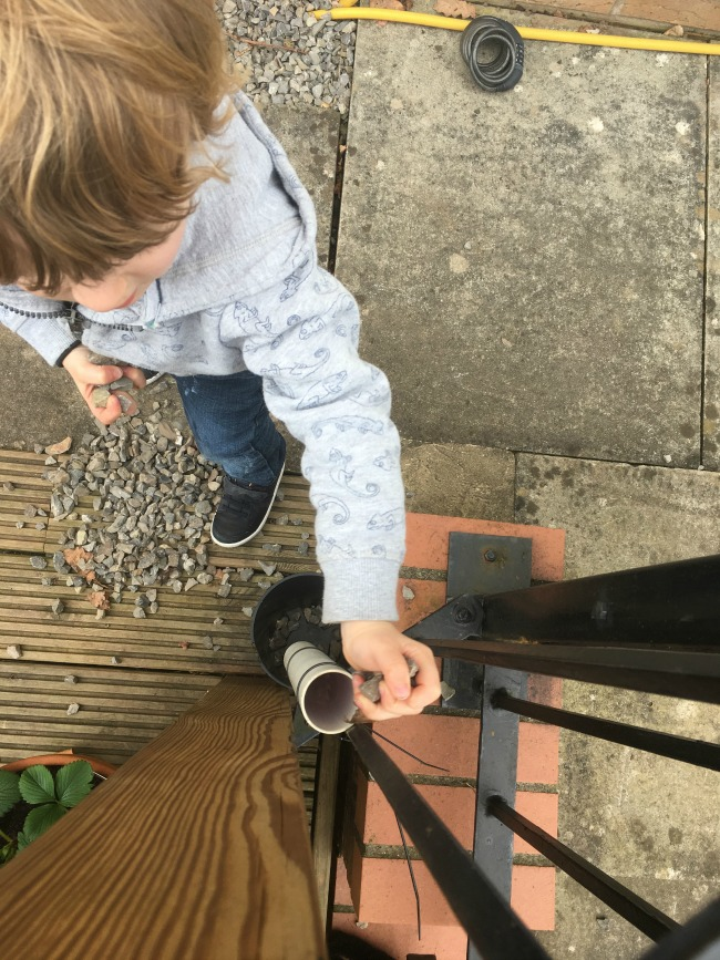 10-five-minute-games-for-toddlers-image-of-toddler-playing-down-the-drainpipe