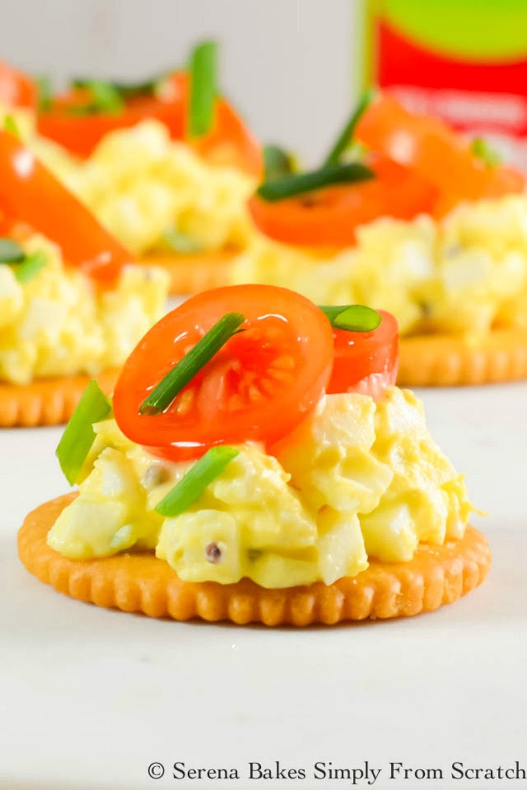 The best easy Egg Salad recipe to serve on crackers with a slice of tomato and chives for an easy appetizer or to fill an Egg Salad Sandwich from Serena Bakes Simply From Scratch.