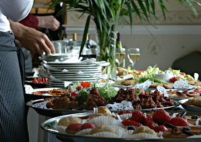 Yes, catering! Preparing to feed 50 or more of your closet friends and family may turn out to be more expensive - guests helping themselves with food on a table - Wedding blog - wedding planners - Weddings by K'Mich - Philadelphia PA