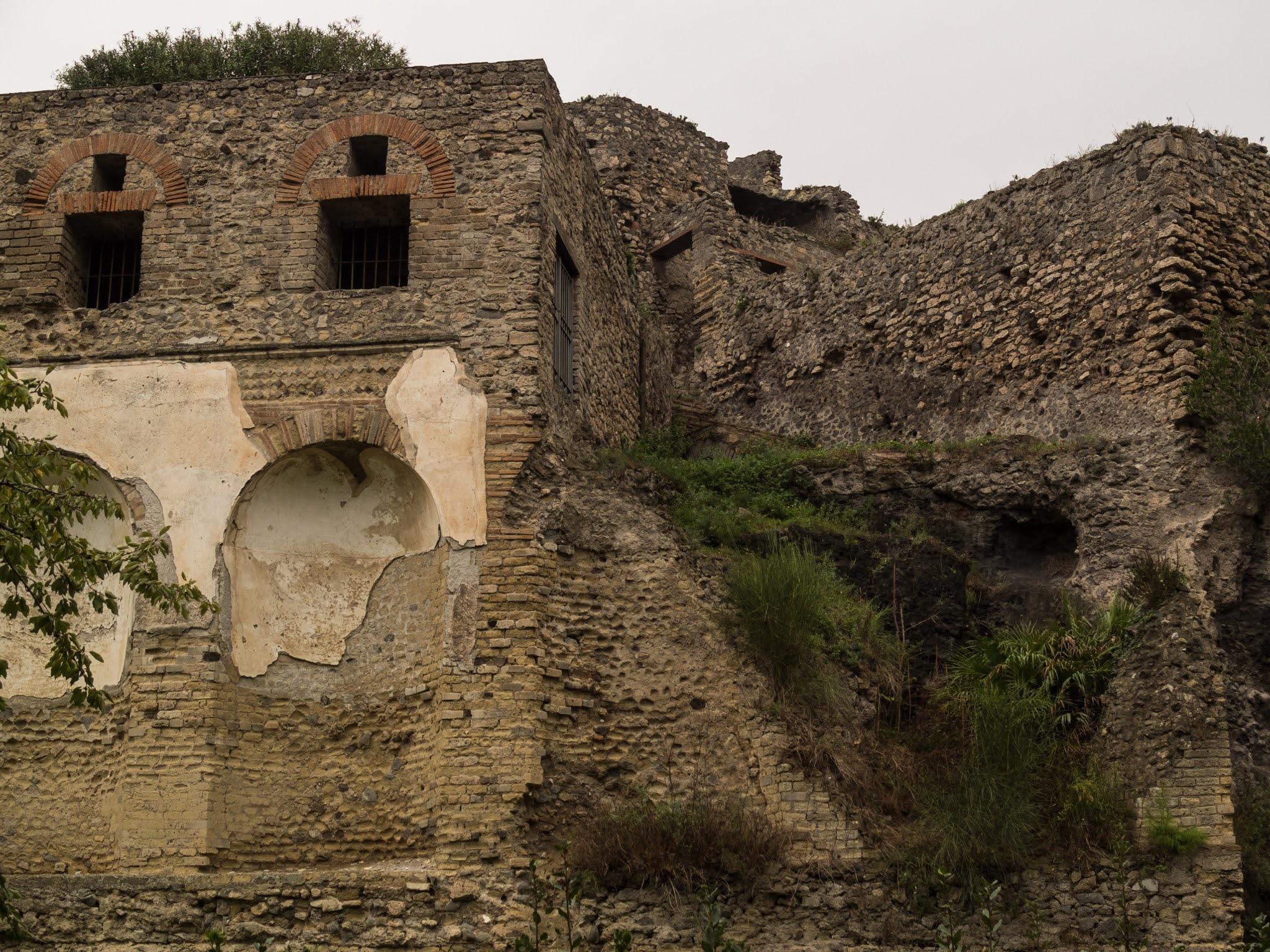 Looking up at doorways and exterior walls in ancient Pompeii.