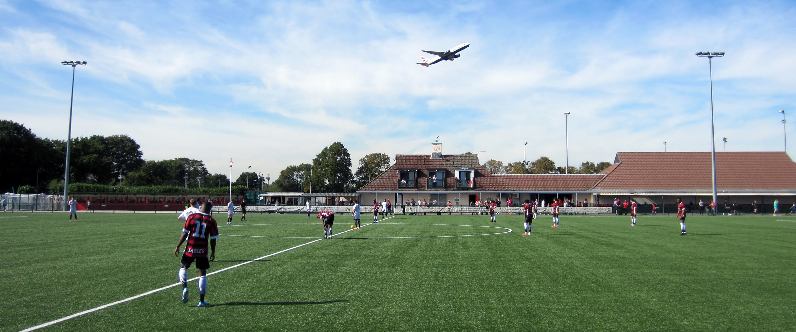 A plane takes off above Bedfont Sports Recreation Ground