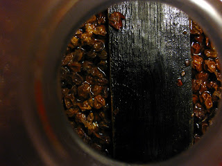 The aging beer with currants and oak floating.