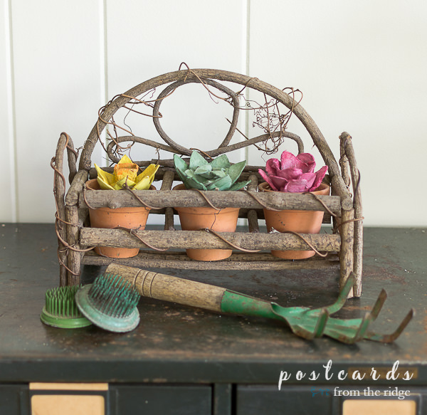 vintage garden tools and colorful flowers made from paper egg cartons