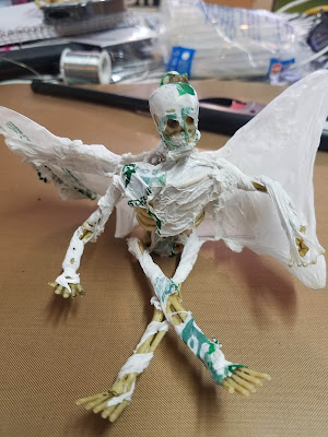 Skeleton with plastic bag melted around it.