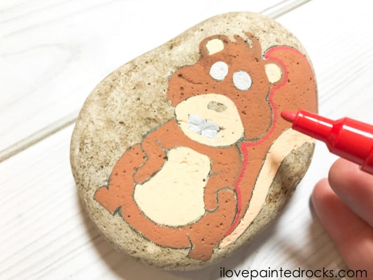 adding red color to the squirrel rock stone
