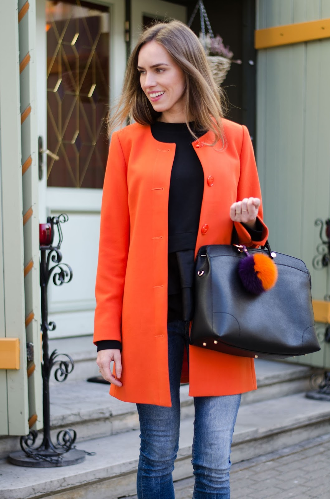 kristjaana mere orange coat black sweater spring fashion