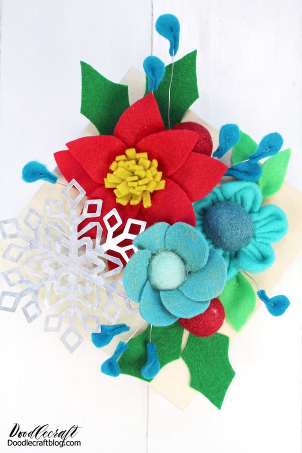 How to Make Felt Flower Holiday Decor! Felt flowers are lush and rich, vibrant in color and fun to make! Learn how to make felt flowers for holiday or home decor.   Add a galvanized snowflake for a fun Winter touch. Perfect decor through the new year. Makes a great handmade gift too.