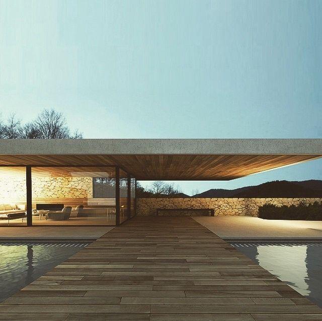 Rumah minimali modern atap melayang dengan dinding kaca dan kolam