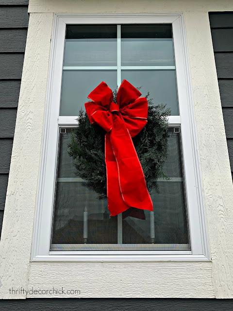 attach Christmas wreaths to windows