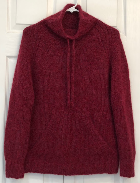 Sweater with funnel neck and pouch knitted with DROPS Air Ruby Red
