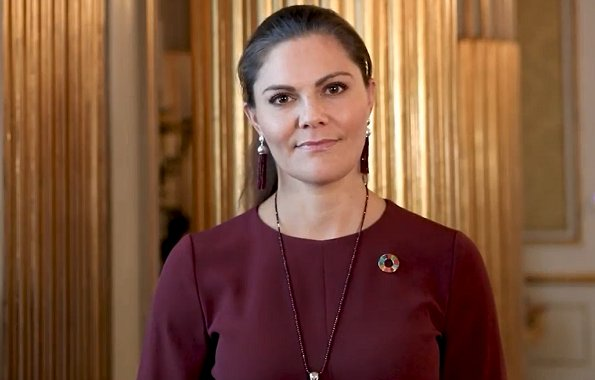 Crown Princess Victoria wore a wine red kamille trousers and kiana blouse from Andiata. Princess Victoria joined the UN alumni advocate group