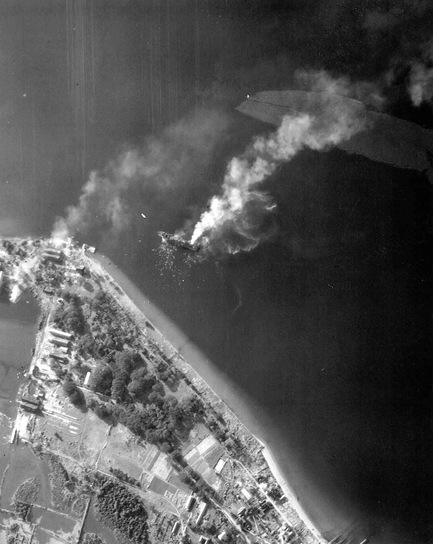 Aerial image Oryoku Maru burning at Subic Bay after the attack on 15 December 1944
