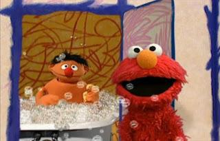 Elmo opens the door and encounters Ernie taking a bath in a tub. Sesame Street Elmo's World Bath Time