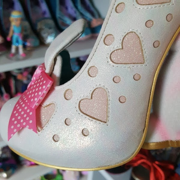 close up of glitter heart cut outs on uppers of shoe