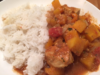 Slow Cooker Chicken and Butternut Squash Curry on a plate with rice