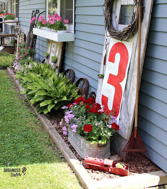 Photo of side yard junk garden decor