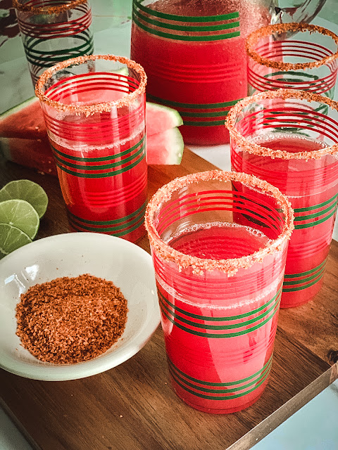 Fabulous fresh Watermelon Juice, naturally sweet, refreshing chunks of watermelon that yield a superb juice, perfect on a hot summer day.    The ingredients are simple, only one, watermelon with a rub of a cut side of lime on the rim of the glass and dipped in the spicy Tajin, tasty.
