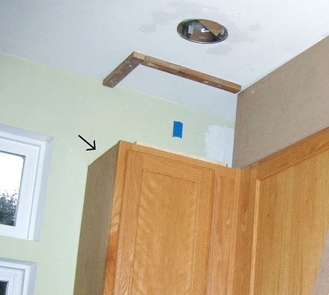 Builder's grade kitchen updated by closing space above cabinets