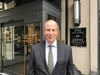 Peter Slatin standing outside the Loews Regency Hotel at 540 Park Avenue in New York City