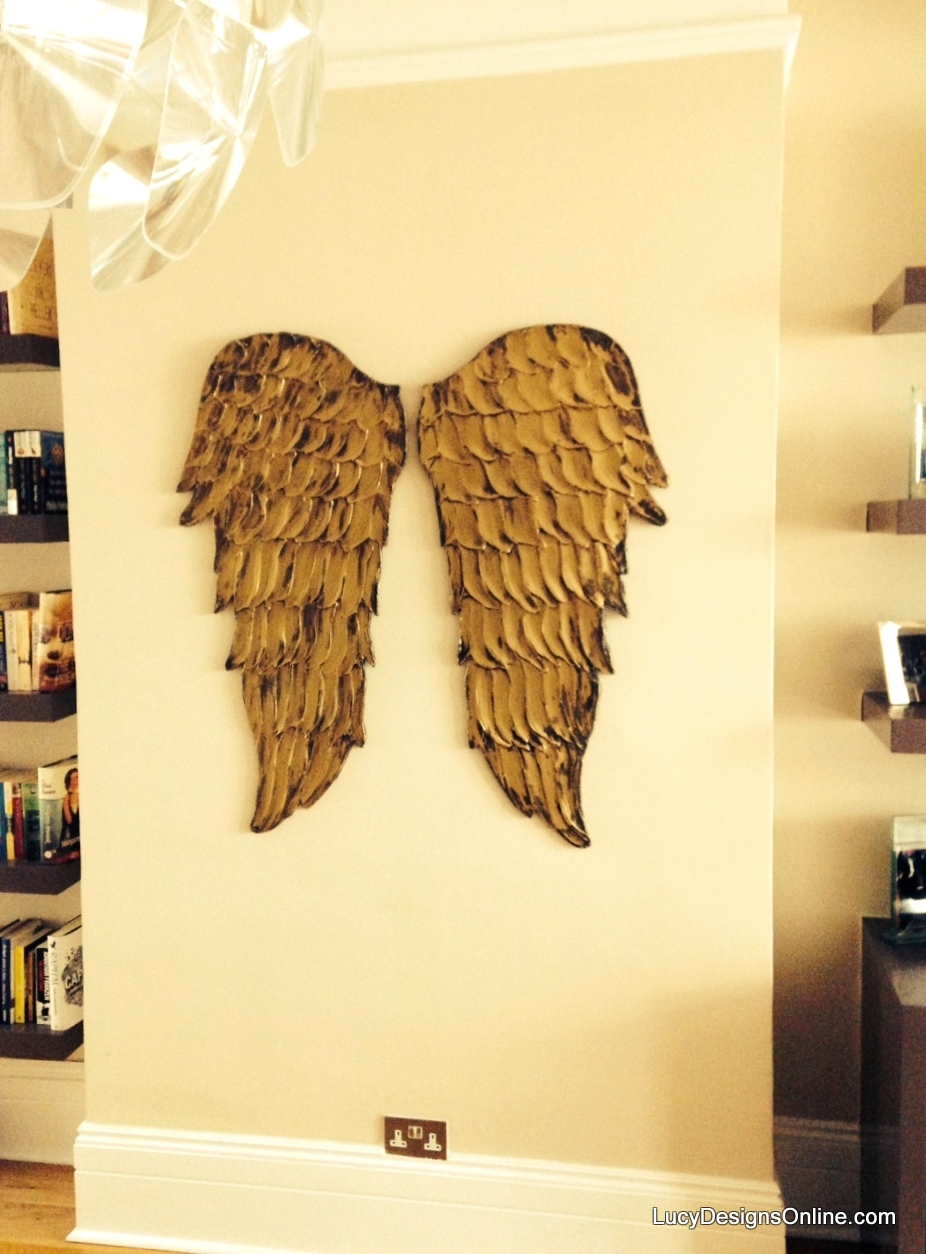 wood angel wings in gold