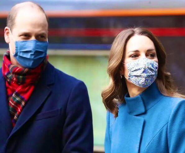 Kate Middleton wore a khaki coat and tartan scarf from Alexander McQueen, and blue coat and black gloves from Catherine Walker. Meghan Markle