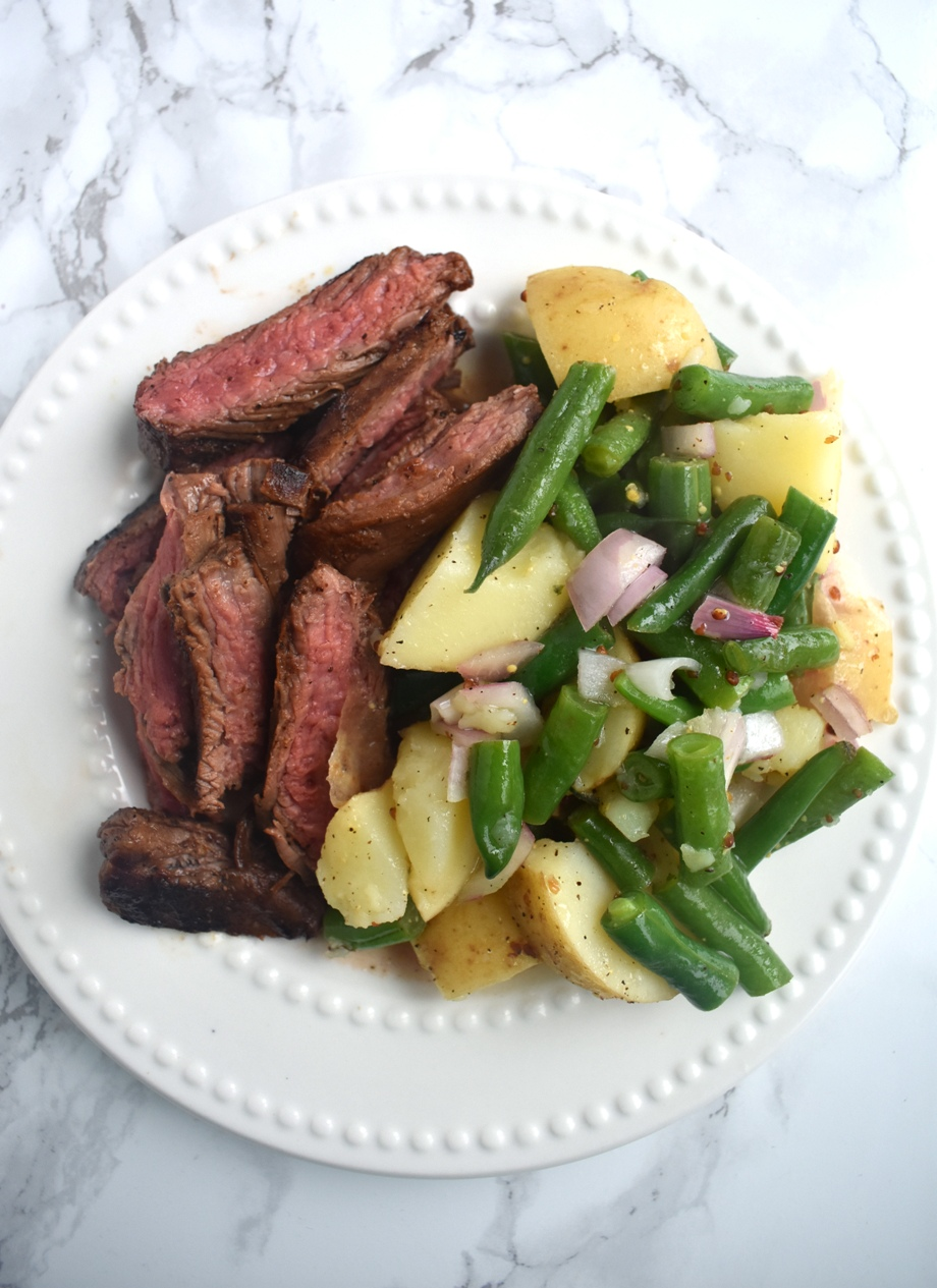 Seared steak with warm potato and green bean salad