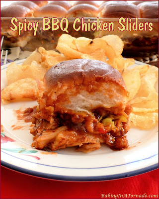 Spicy BBQ Chicken Sliders, you can adjust the heat according to your tastes in these baked barbecue chicken sliders. A fun lunch, dinner, or party food. | Recipe developed by www.BakingInATornado.com | #recipe #chicken