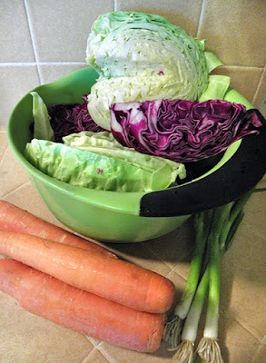 Carrots, cabbage wedges, and green onions