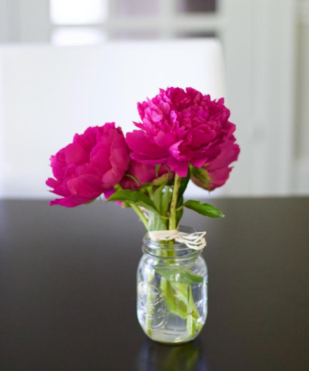 Hot pink peonies in a jar